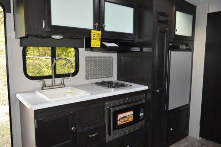 2019-Venture-RV-Sonic-Lite-SL169VUD-Travel-Trailer-031105-Kitchen-0723664001549316624-large